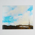 "Hollywood Sign. The iconic Hollywood sign as you've never seen it. Printed with metallic ink, casting a shimmer like no other. 16"" x 20"" Matted."