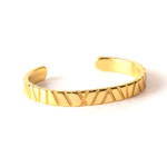 Bamboo Collection. 18 Karat gold over steel cuff from a vintage automobile.