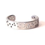 Galileo Collection. Nickel over steel cuff from a vintage automobile.