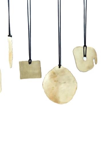 Rocks Collection. Vintage Brass pendants on silk cord with shapes inspired by the rock formations at Joshua Tree.
