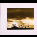 "The Santa Monica Pier as seen in a new light. A sepia photograph printed with metallic ink, a unique, haunting image. 16"" x 20"" Matted."