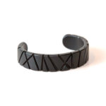 Bamboo Collection. Matte black steel cuff from a vintage automobile.