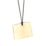 Rocks Collection. Vintage Brass, large pendant with silk cord.