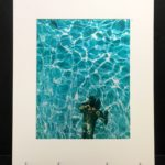 Weems in Pool. Colorful photo printed with metallic ink, creating an almost 3-D effect.